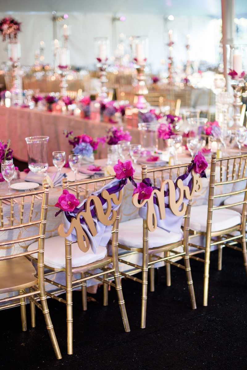 gold laser cut mr. and mrs sign, purple ribbons fuchsia orchids