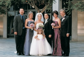 Portrait of newlyweds with family and friends