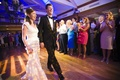 Bride and groom make entrance into wedding reception