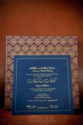 Indian floral motif on purple and gold envelope