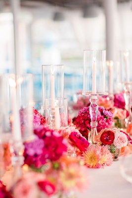 warm color scheme for wedding reception, dahlias, peonies, and hydrangeas in magenta, red, peach