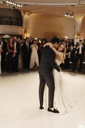 bride in strapless wedding dress naeem khan groom in loafers tuxedo first dance white dance floor