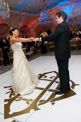 First dance on monogram wedding reception dance floor