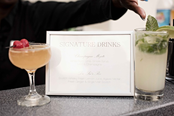 signature drink signage flanked by cocktails fruity mixed drinks embellishments wedding reception