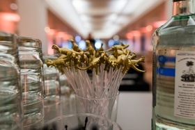 Gold dinosaur t-rex toppers on swizzle sticks drink stirrers at bar The Field Museum