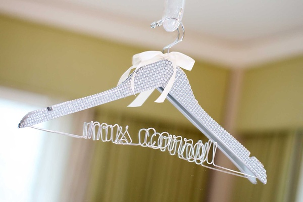 "Chad Carroll's wife Jennifer Stone clothing hanger with ""Mrs. Carroll"" wire design"