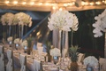 intimate destination wedding in hawaii, floral arrangements with white orchids alternated with pinea