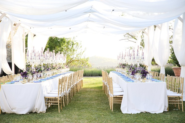 destination wedding in tuscandy, two king's tables, drapery above