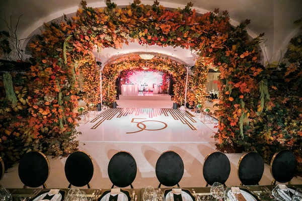 50th anniversary party with fall foliage and art deco decor