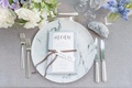 geode at wedding place setting, marble charger plate, bluebell flowers
