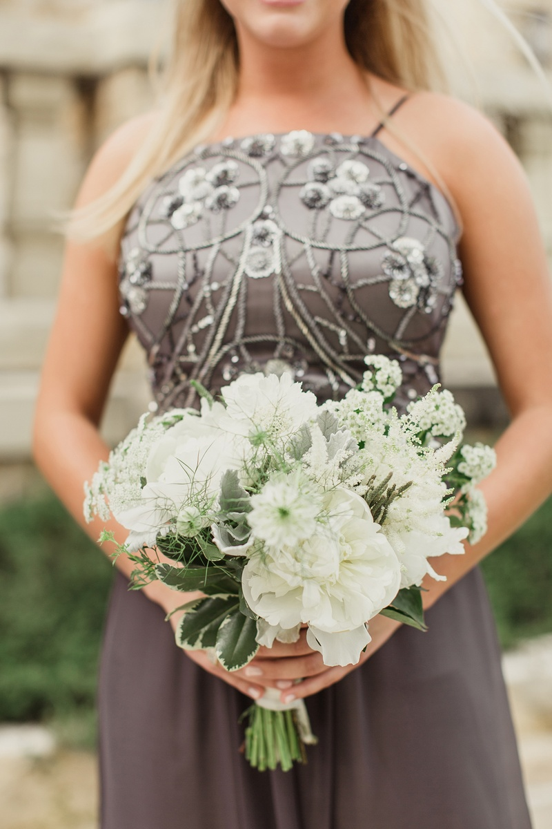 Bridesmaid bouquet with white flowers and greenery grey beaded dress