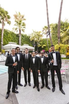 Groomsmen in bow ties at Viceroy Santa Monica pool