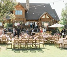 Outdoor wedding reception malibu estate venue backyard wedding balloons umbrellas pink wood greenery