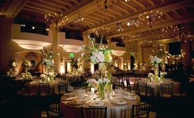 White and light pink flower arrangements at wedding reception