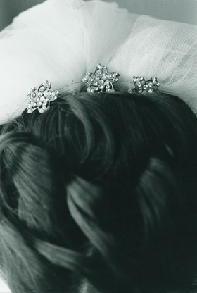 Black and white photo of updo and headpiece