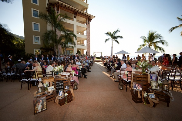 Mexico wedding with family photos on wood crates at entrance