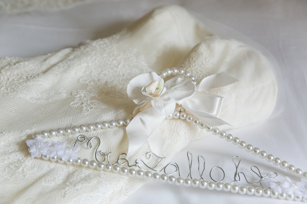 pearl clothes hanger custom writing classic wedding unique detail bow ribbon gown bride