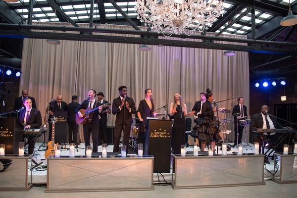 The Gold Coast All Stars at wedding in chicago revel motor row purple lighting drapery chandelier