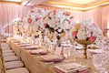 wedding reception long table gold linen high low centerpieces white blush peach coral rose orchids