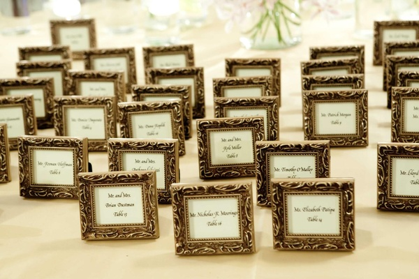 Gold frame around table cards in calligraphy
