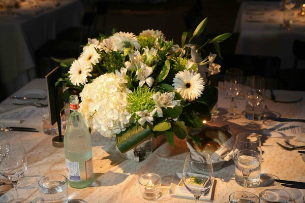 Daisy, hydrangea, and lily wedding centerpiece
