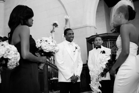 Black and white photo of Jarett Dillard at wedding altar