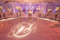 Gobo lighting monogram on ballroom reception floor