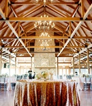 Wedding place card table covered in gold sequined tablecloth at The Pavilion at Orchard Ridge Farms