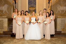 bridesmaids in metallic adrianne papelle, bride in monique lhuillier ball gown