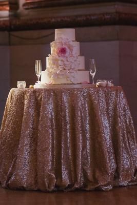 Four layer round wedding cake with sugar rose