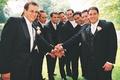 Groom and groomsmen in sports handshake before wedding