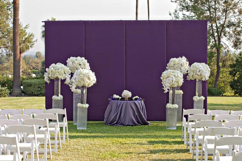 Ceremony Décor Photos - Purple Ceremony Backdrop - Inside Weddings