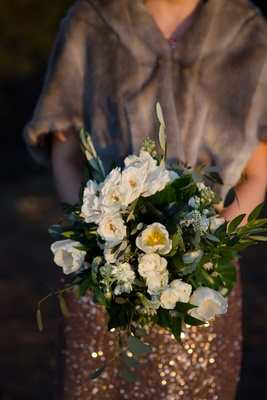 wedding bouquet bridesmaids sparkle dress fur wrap greenery bouquet white flowers rose tulip blooms