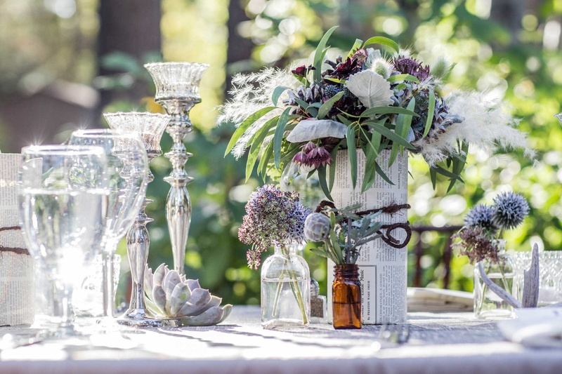 wildflower centerpieces, wildflowers in bookpages and small bottles, silver candlesticks