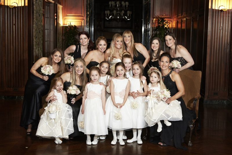 Bridesmaids and flower girls in pretty dresses