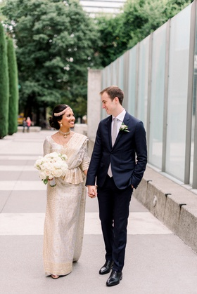 intercultural bride and groom, south asian bride in gold and ivory sari, white groom in navy suit