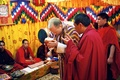 Groom bows down during traditional Buddhist wedding