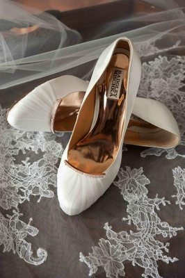 Badgley Mischka bridal shoes on lace veil