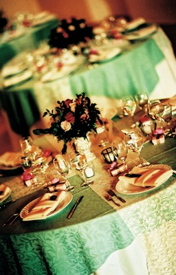 Pattern green linens with white lace runner and small centerpiece
