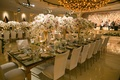 Wedding reception long table with tall centerpieces, dance floor, live band stage with glitter
