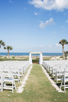 amelia island florida wedding on lawn with palm trees and ocean view