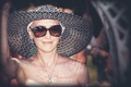 Jen Bulik in sun hat and sunglasses at her wedding