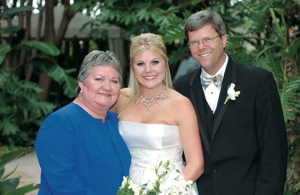 The bride with her parents after ceremony