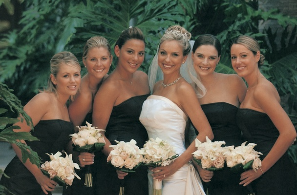 Bride with bridesmaids in black strapless dresses