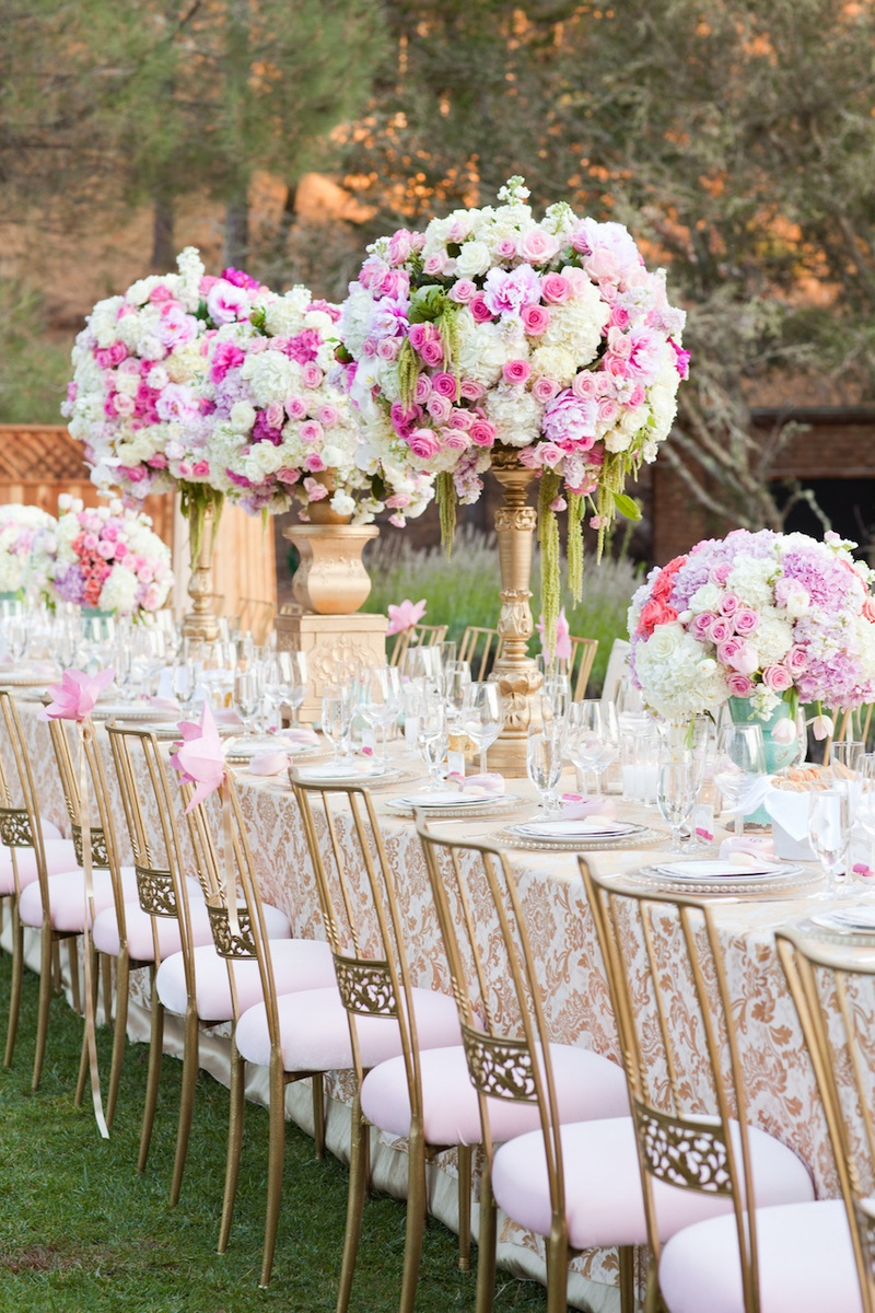 Outdoor wedding with pink gold dcor at a vineyard in california outdoor wedding reception table with gold white damask tablecloth golden chairs with pink cushion junglespirit Choice Image