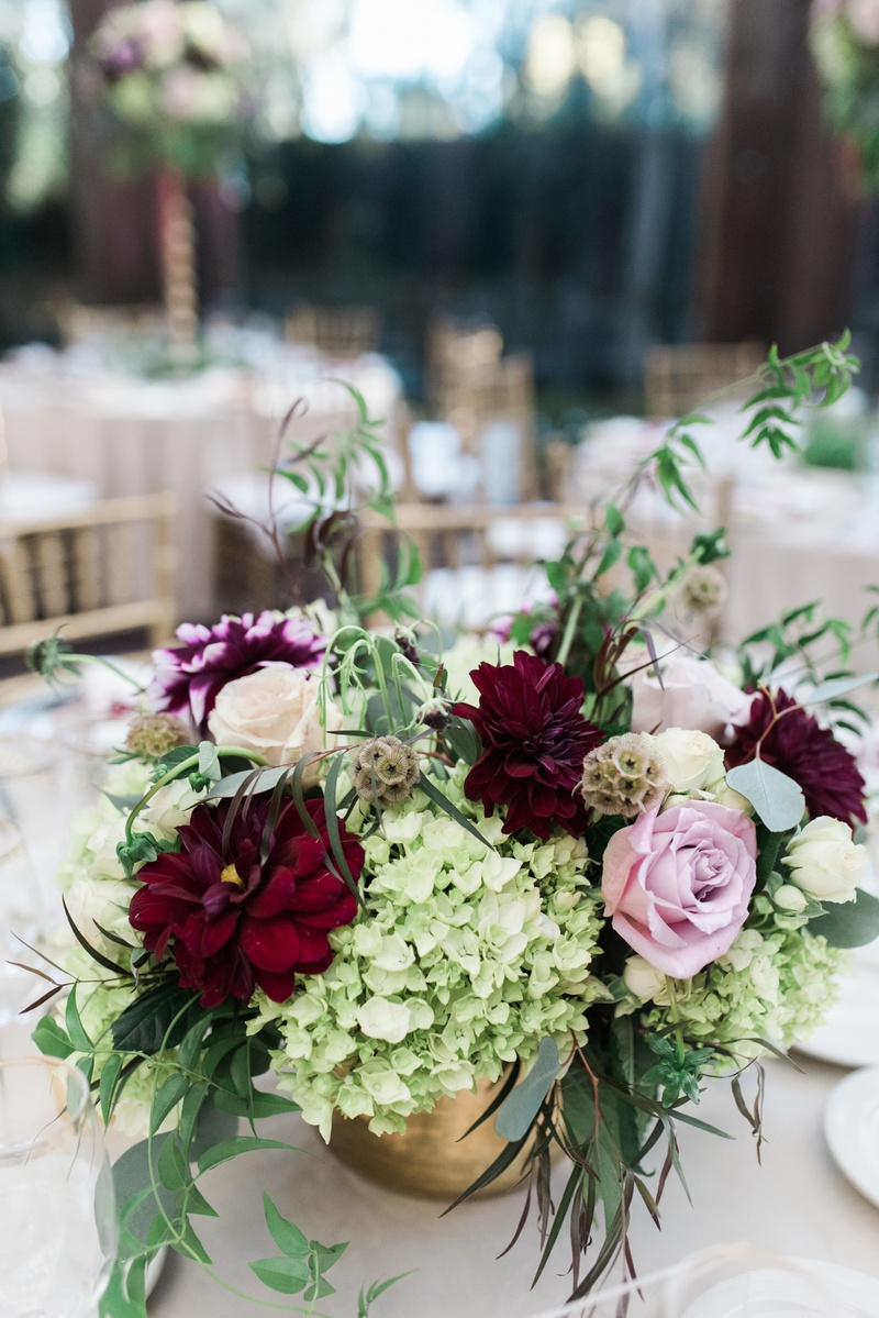 fall wedding small centerpiece with burgundy and blush flowers, greenery, gold vase