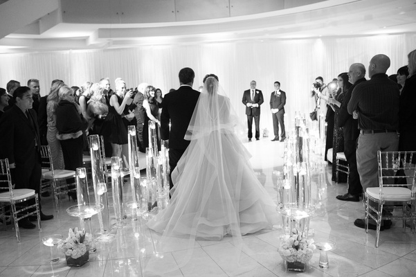 Black and white photo of indoor ceremony processional