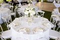 mercury glass vases, white flowers, geometric linens, silver place settings, grey wooden chairs