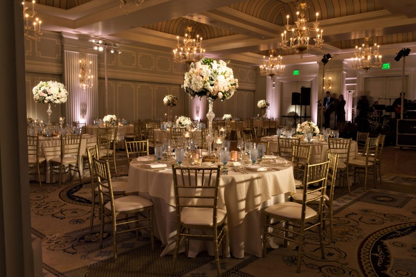 Wedding reception classic ballroom style Casa Del Mar tall centerpieces uplighting chandeliers