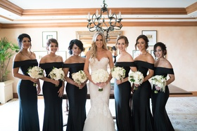 Stephanie Ming with bridesmaids in off the shoulder black long dresses white bouquets greenery updos
